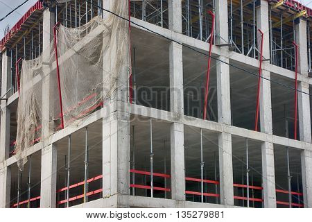 corner of concrete building under construction with monolithic reinforced concrete frame in Moscow Russia