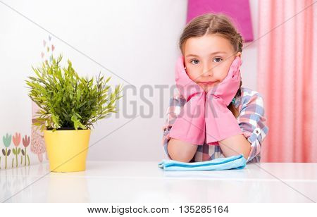 little cute kid bored cleaning up room