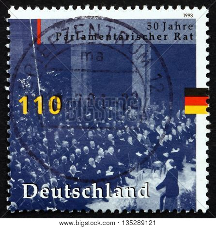 GERMANY - CIRCA 1998: a stamp printed in the Germany shows Parliamentary Council Bonn 1948 Convening to Draw up Constitution circa 1998