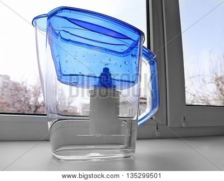 Water filter jug on the windowsill poster
