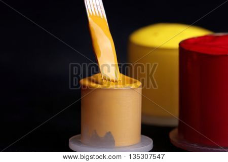 Tattoo needle with yellow and red ink