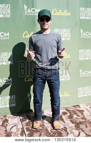 ARLINGTON, TX - APR 18: Justin Moore attends the ACM & Cabela'??s Great Outdoor Archery Event during the 50th Academy Of Country Music Awards at the Texas Rangers Youth Ballpark on April 18, 2015.