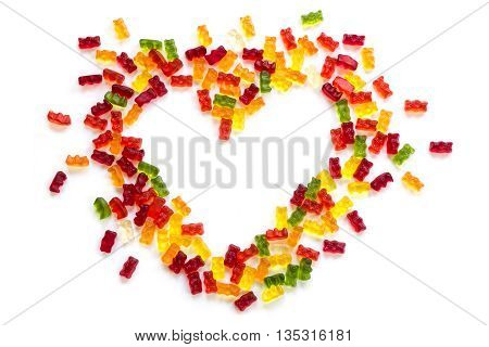 heart shape made of colorful gummy bears isolated with small shadow on a white background love concept for birthday valentines or mothers day