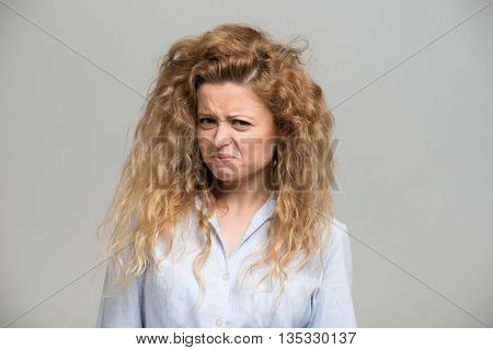 Woman making a disgusted expression