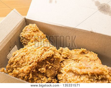 fried chicken set in a box .