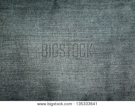 Texture of black jeans for background .