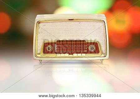 vintage radio with retro disco colorful background