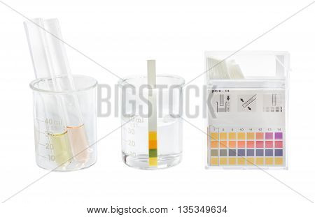 pH paper indicators and tube solution with pH values test