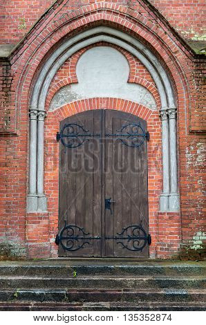 The old doors and stairs in the red brick wall.