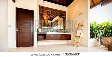 Outdoor Washroom With A Mirror And Cabinets