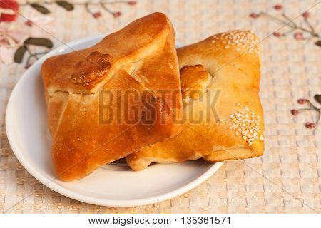 Pasties Stuffed Meat On Tablecloth Background, Close Up