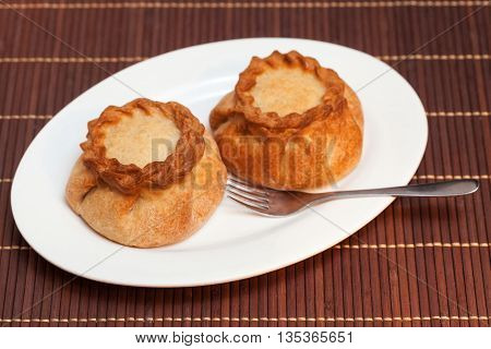 Round Pasties Stuffed Meat On Bamboo Napkin, Close Up