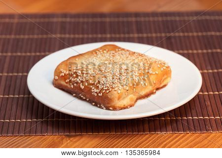 Pasty Stuffed Meat On A Dark Wood Background