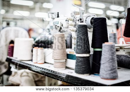Wool and thread spools on desk used in textile industry