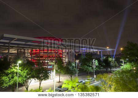 DALLAS USA - APR 9: Modern architecture at the Performing Arts Center in Dallas illuminated at night. April 9 2016 in Dallas Texas United States