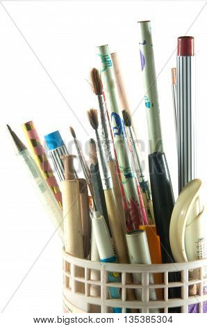 holder full of pen and pencil isolated on white background