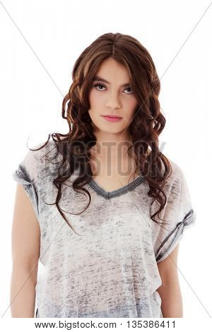 Young unhappy woman with long dark hair.