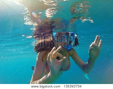 Underwater View Of A Woman Snorkeling In The Tropical Sea