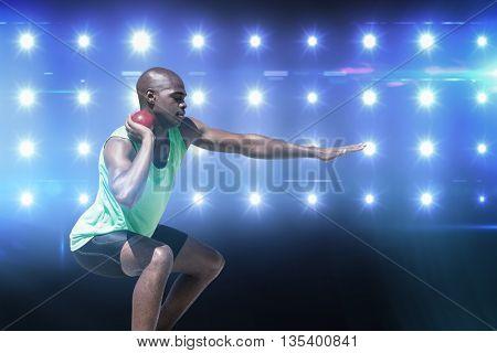 Sportsman practising the shot put against composite image of blue spotlight