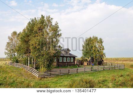 Small farmstead in North of Russia sunny autumn day