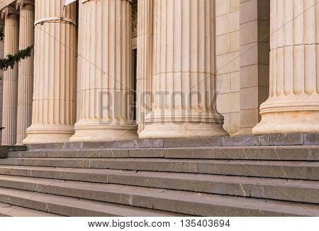 Many old greek columns in a row
