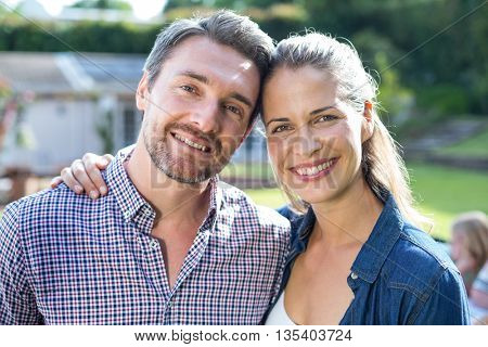 Portrait of happy young couple in back yard