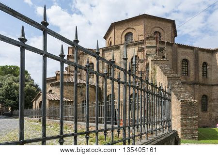 RAVENNA,ITALY-AUGUST 21,2015:view of the San Vitale basilica in Ravenna-Italyduring a architectural renovation in a cloudy day.