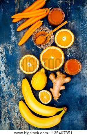 Carrot ginger immune boosting anti inflammatory smoothie with turmeric and honey. Detox morning juice drink clean eating