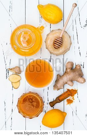 Hot lemon water with ginger cayenne turmeric and honey. Detox liver fat burnner immune boosting anti inflammatory healthy drink