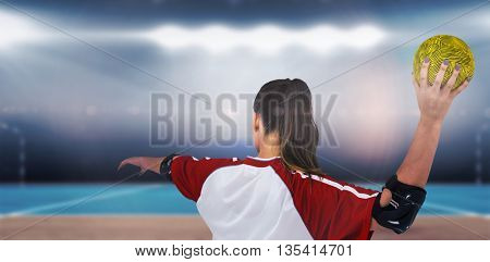 Sportswoman throwing a ball against digital image of handball field indoor