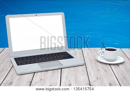 Modern Laptop with Cup of Coffee in front of Ocean extreme closeup. 3d Rendering