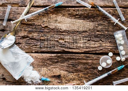 Syringes, Drugs And Other Accessories Addict In The Form Of A Circle With Place For Text On Wooden B