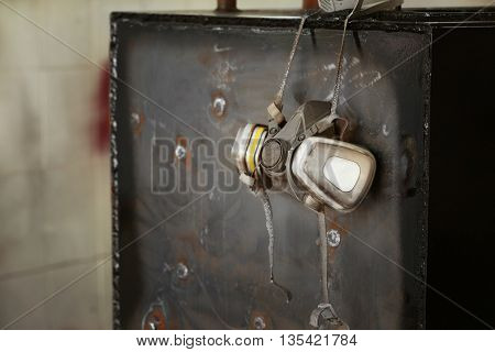 Respirator hanging on metal box