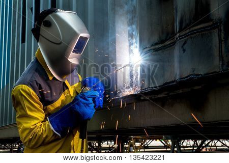 Industry Woker Welding concept - Industry worker with welding steel to repair container structures manufacture workshop. Worker welding in factory industry.