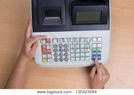 Hand Swiping Credit Card In A Store With Cash Register