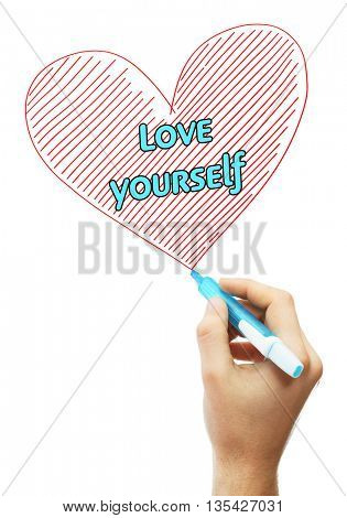Male hand with marker writing Love yourself