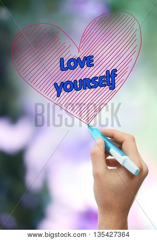 Male hand with marker writing Love yourself on natural background poster