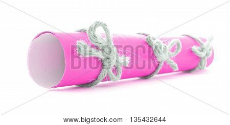 Pink paper scroll tied with string three natural bows isolated