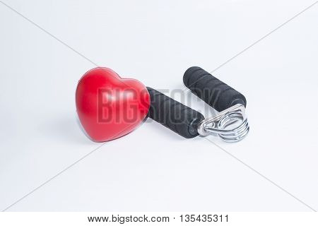 Fitness background with bottle of handgrip and heart