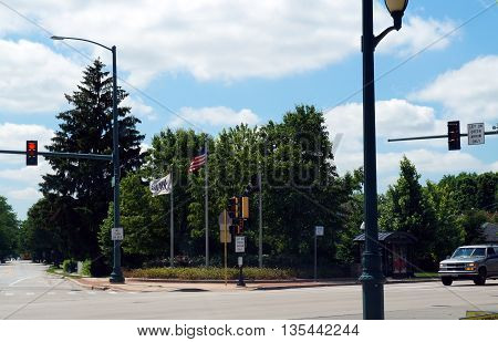 JOLIET, ILLINOIS / UNITED STATES - JUNE 1, 2015: The City of Joliet proudly flies the American flag, the POW-MIA flag, and the Joliet city flag, on a street corner in Joliet.