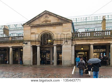 LONDON ENGLAND - OCTOBER 21, 2015: Entrance of Covent Garden market a former vegetable market in London