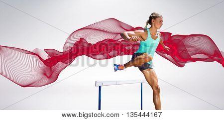 Sportswoman practising the hurdles against blue design