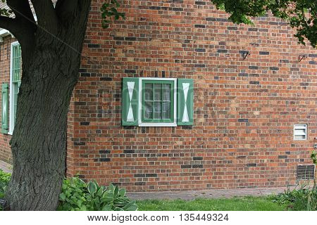 Detail of window and brick work at historical replica of dutch buildings of the 1600's at Windmill Garden in Holland, Michigan