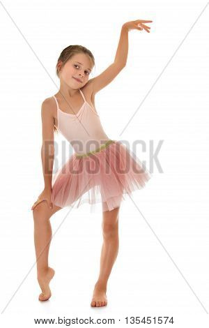 Slender little girl in a pink tracksuit- Isolated on white background