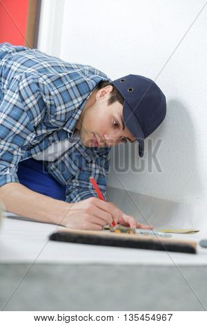 young handyman in uniform
