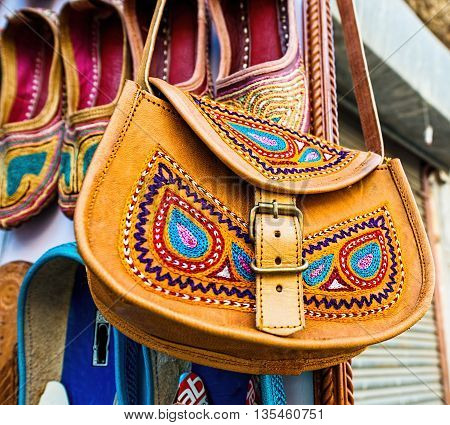 Traditional leather ethnic bag at a market, India