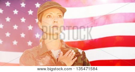 Soldier taking pledge in front of american flag