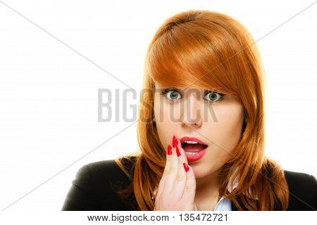 Emotional facial expression wide eyed business woman surprised girl open mouth covering her mouth with hand isolated on white