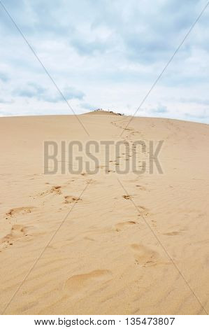 Footsteps leading to the top of Dune of Pilat (Dune du Pilat) the tallest sand dune in Europe located in the Arcachon Bay area France.