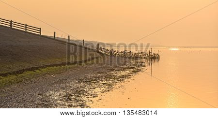 Sea Dike In Orange Haze